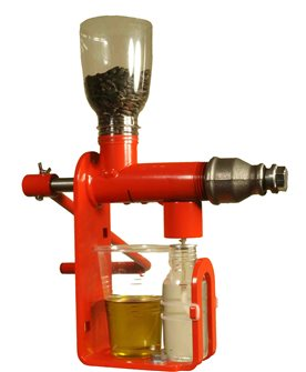 Table oil press for oleagineous seeds